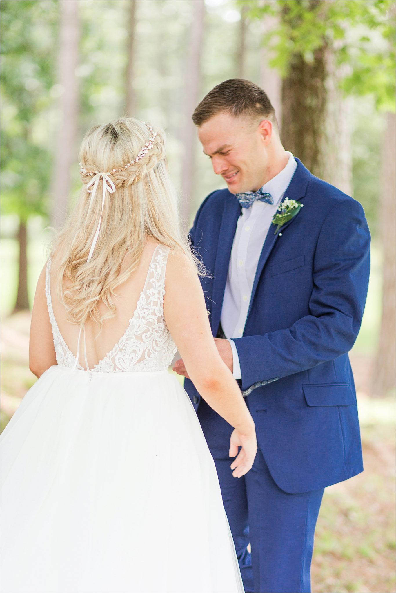 blue-suit-groom-bride-bow-tie-first-look