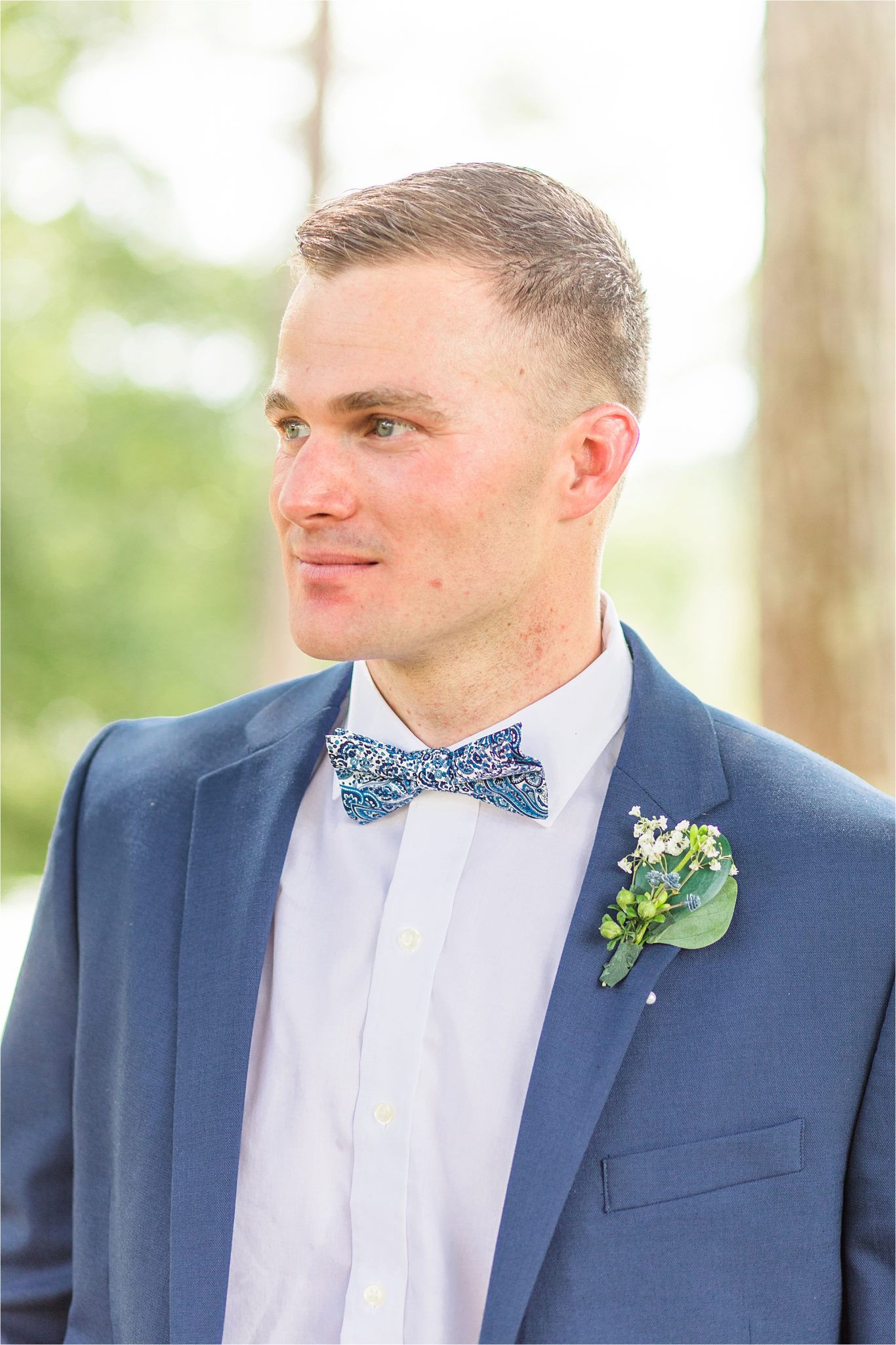 blue-grooms-suit-patterned-bow-tie-clean-cut-fitted-white-dress-shirt-portrait