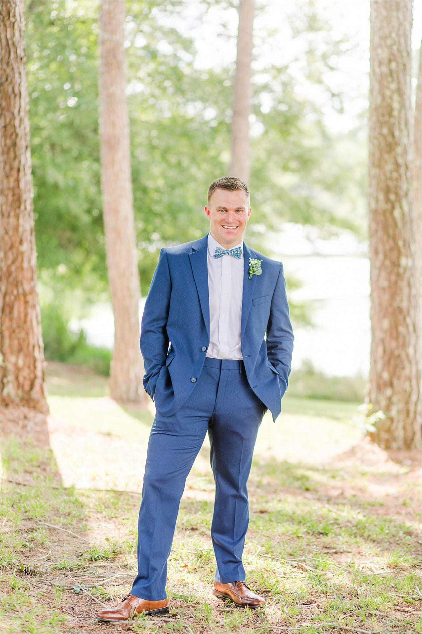 blue-grooms-suit-bow-tie-clean-cut-fitted-white-dress-shirt-portrait