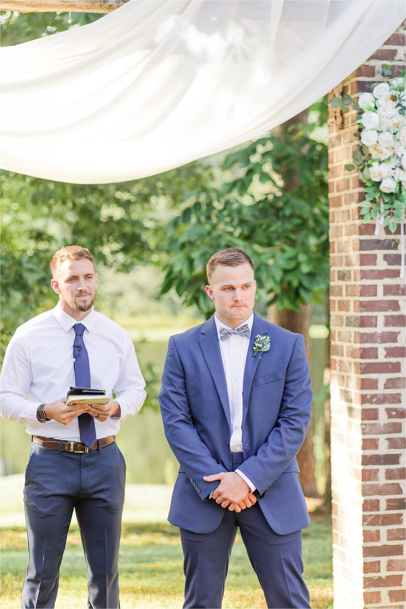 groom at the end of the aisle-blue-steel-wedding-color