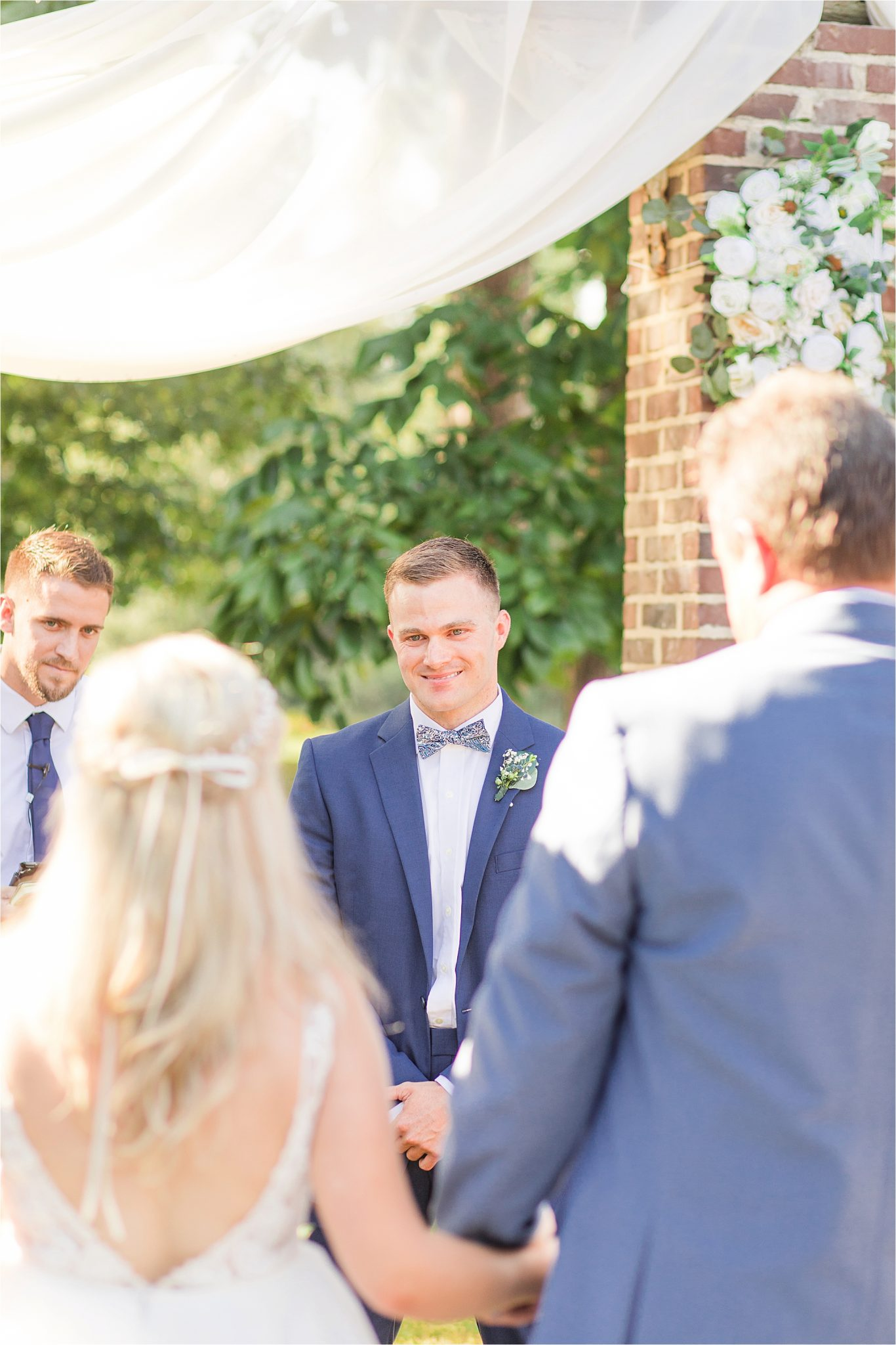 groom at the end of the aisle-blue-steel-wedding-color-first-look