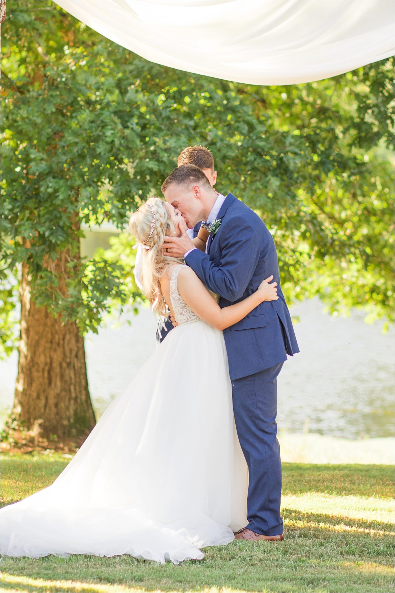 wedding-ceremony-alabama-wedding-photographer-blue-navy-first-kiss