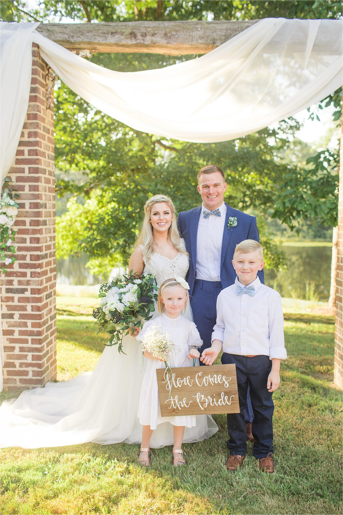 wedding-sign-here comes the bride-flower-girl-ring-bearer-bride-groom