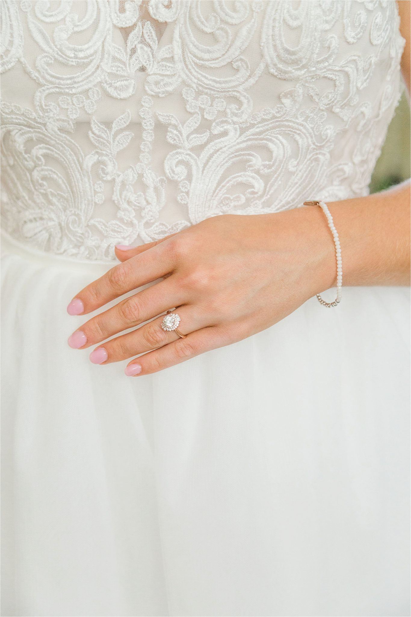 a-line-wedding-gown-lace-detail-unique-wedding-ring-pearls