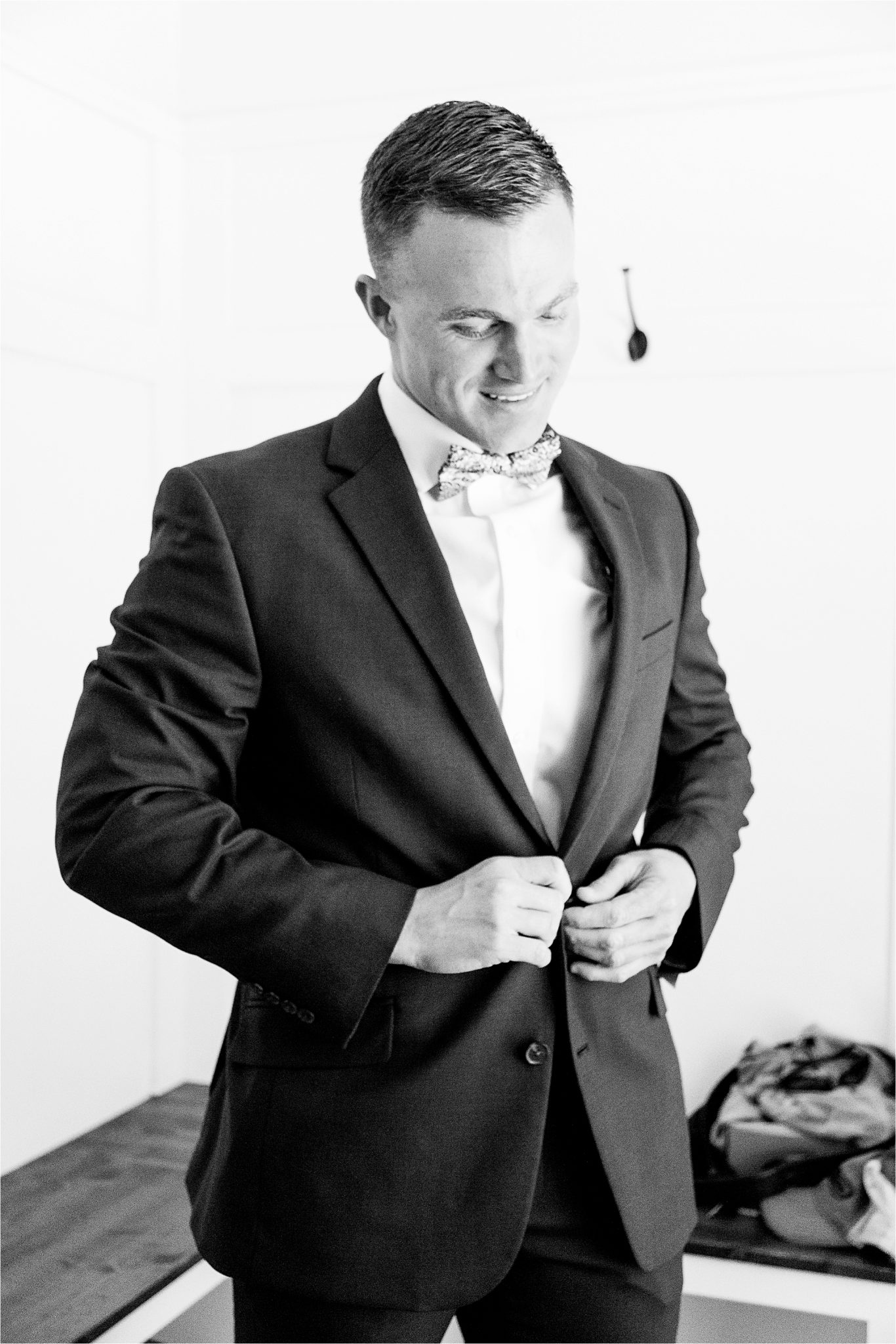 groom-getting-ready-fitted-suit-bow-tie-handsome
