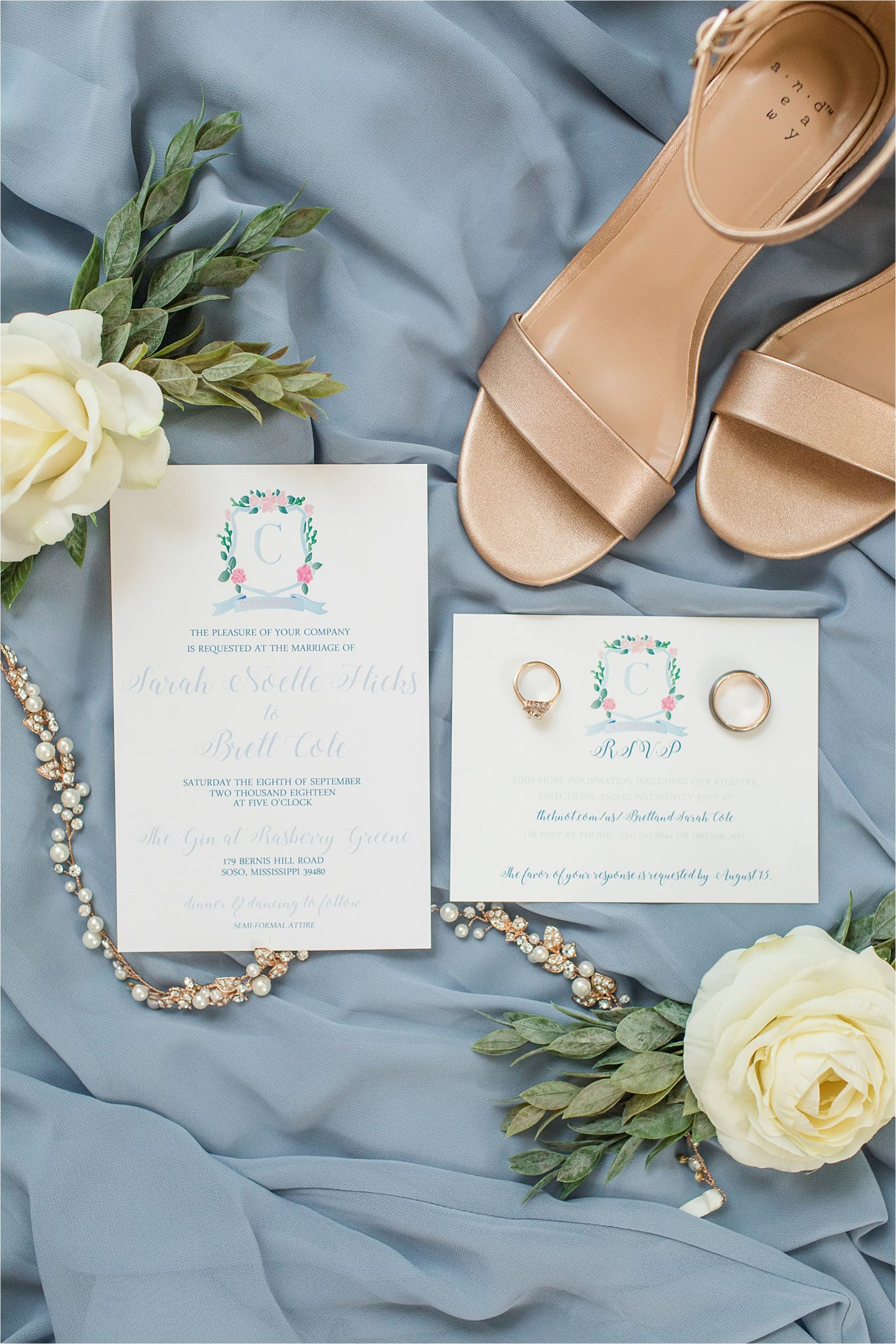 periwinkle-raspberry-wedding-details-invitations-watercolor-family-crest-white-roses-pearls