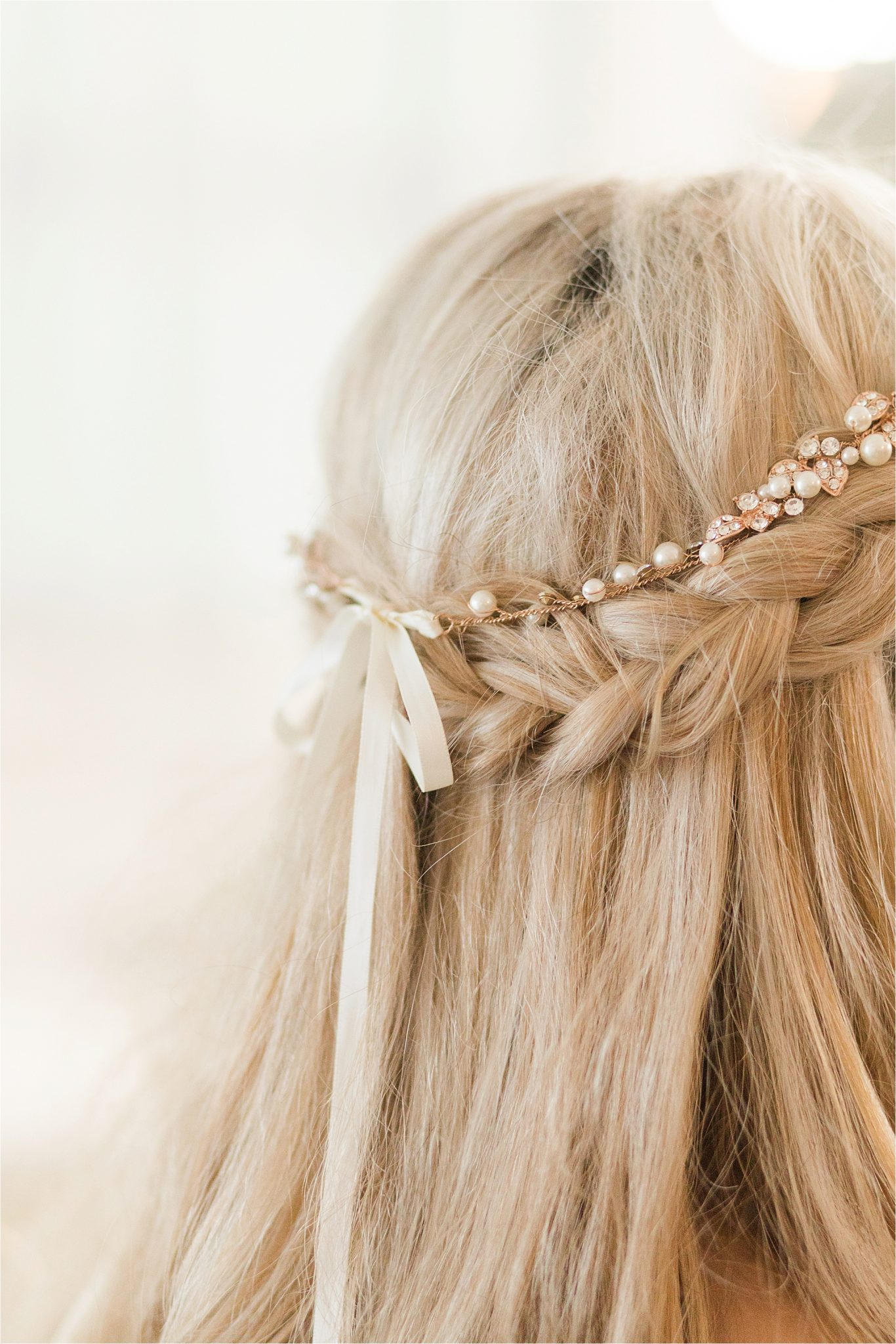 bridal-hair-braid-half-up-down-pearl-crown-bow-blonde-style-ivory