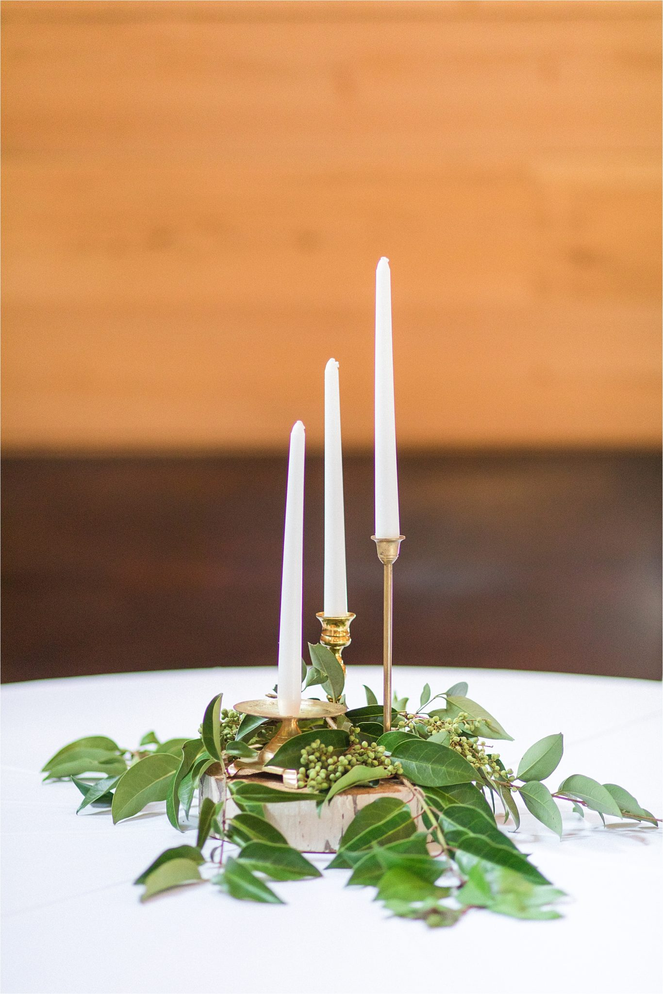 gold-candlestick-centerpieces-vines-white-ivory-greenery