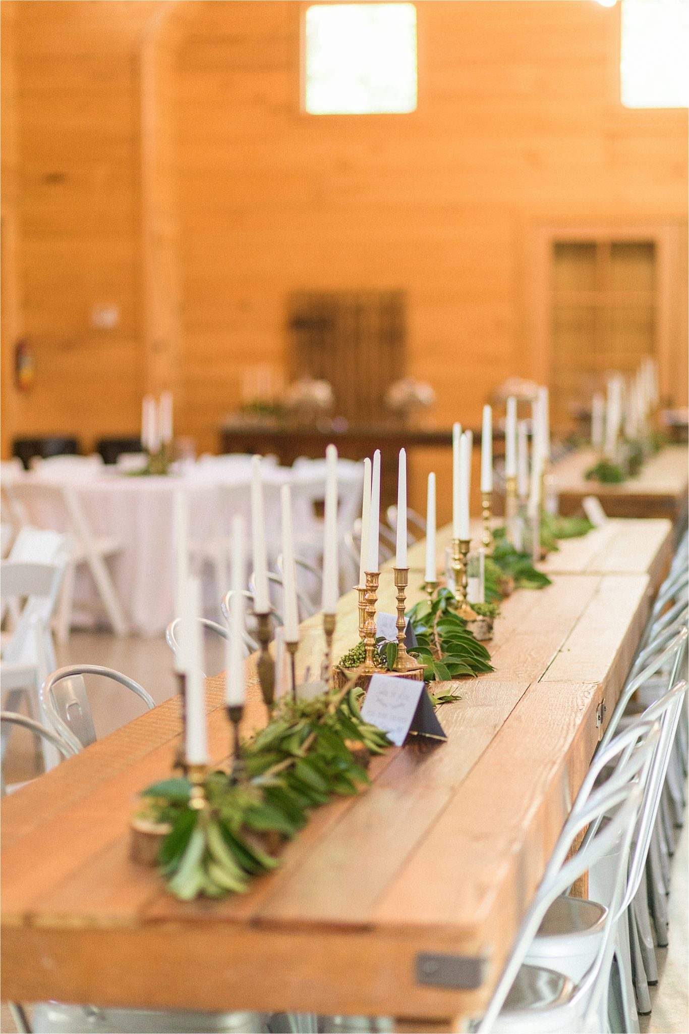 wedding-reception-alabama-venue-barn-farm-tables-metal-chairs-candle-centerpieces-gold-candlesticks