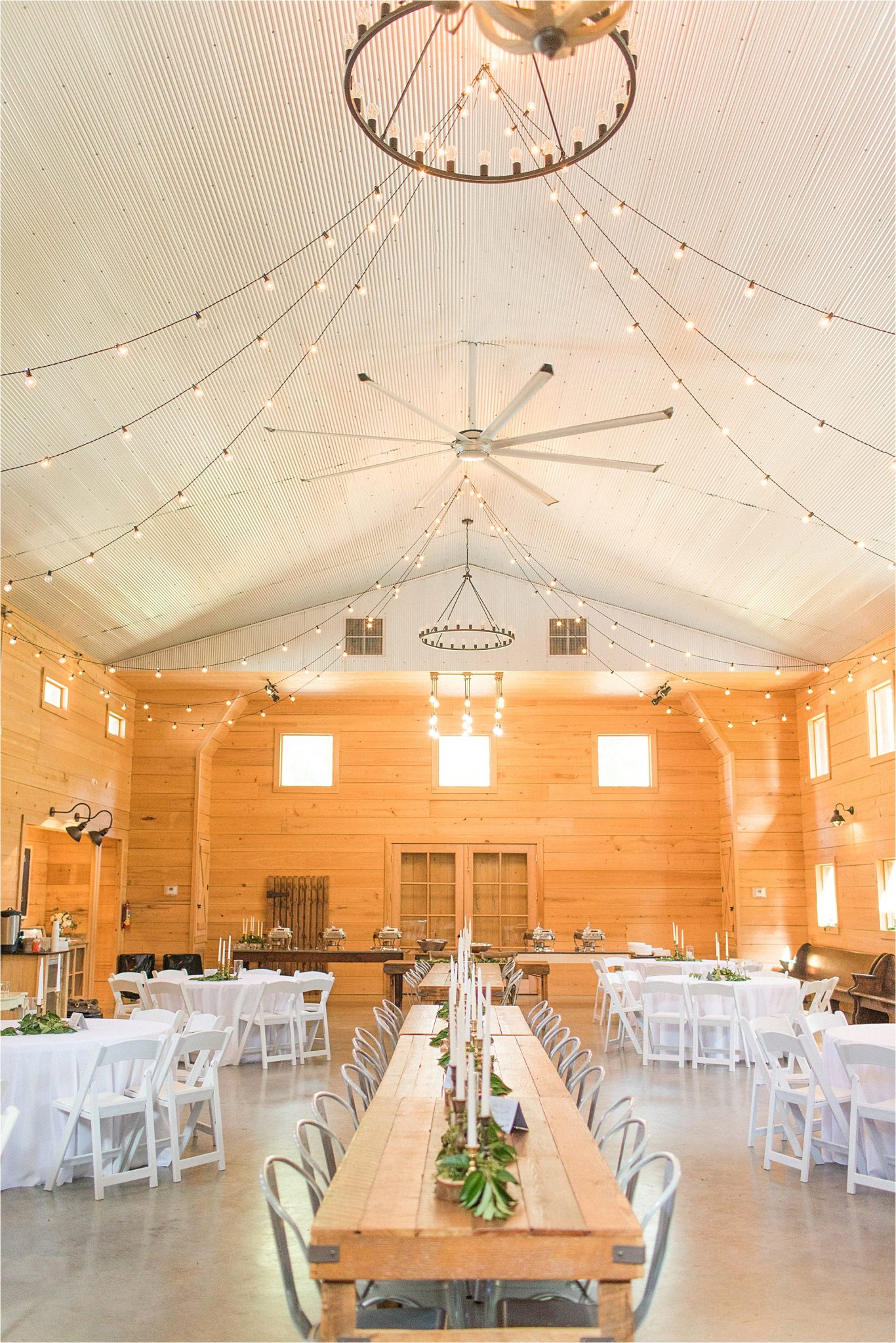 wedding-reception-alabama-venue-barn-farm-tables-metal-chairs-candle-centerpieces-shiplap