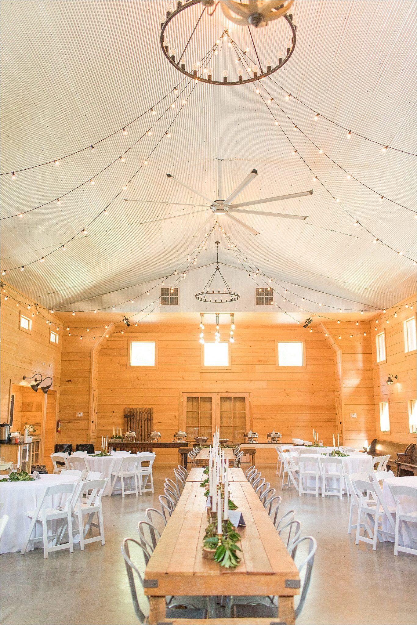wedding-reception-alabama-venue-barn-farm-tables-metal-chairs-candle-centerpieces-shiplap