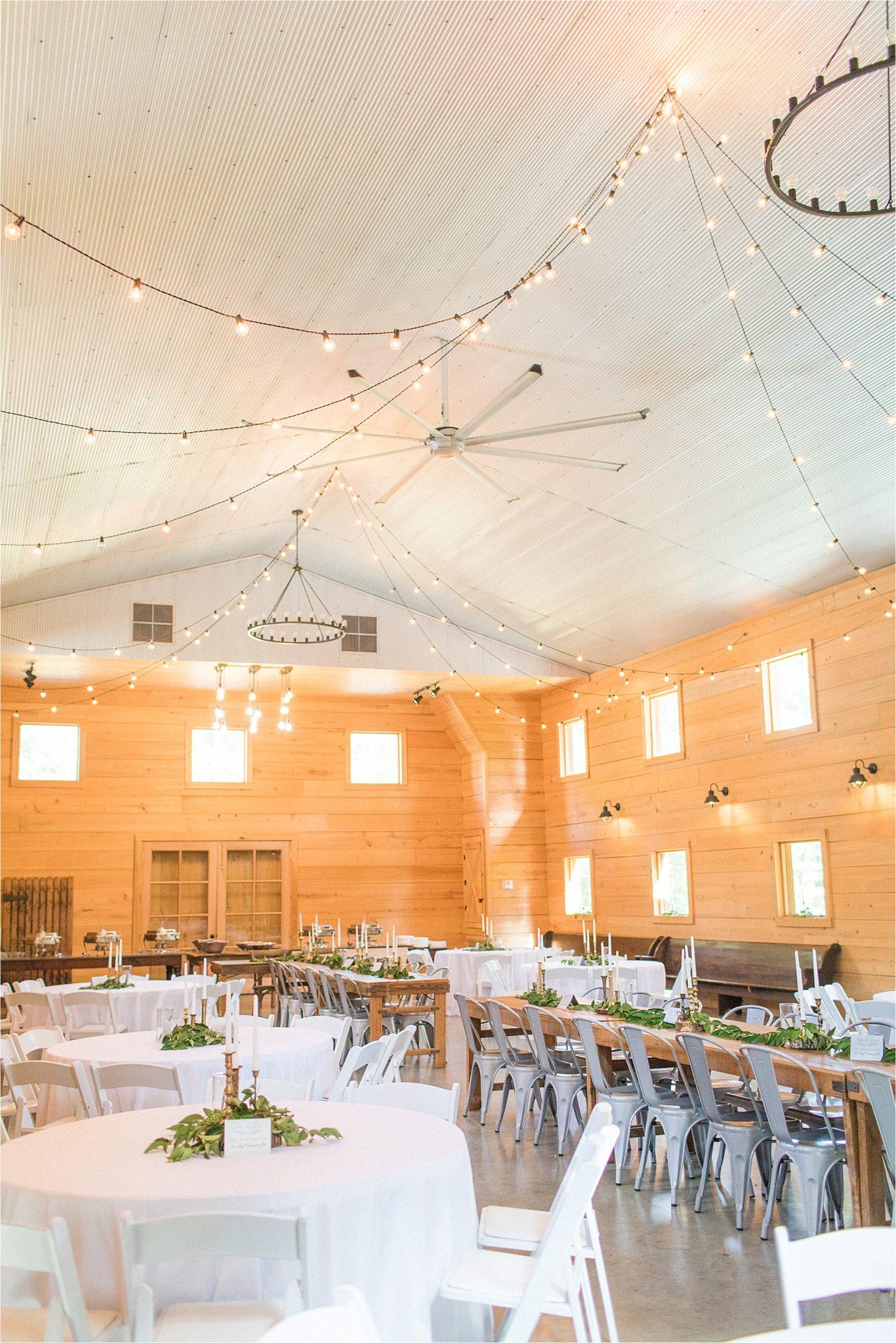 wedding-reception-alabama-venue-barn-farm-tables-metal-chairs-candle-centerpieces