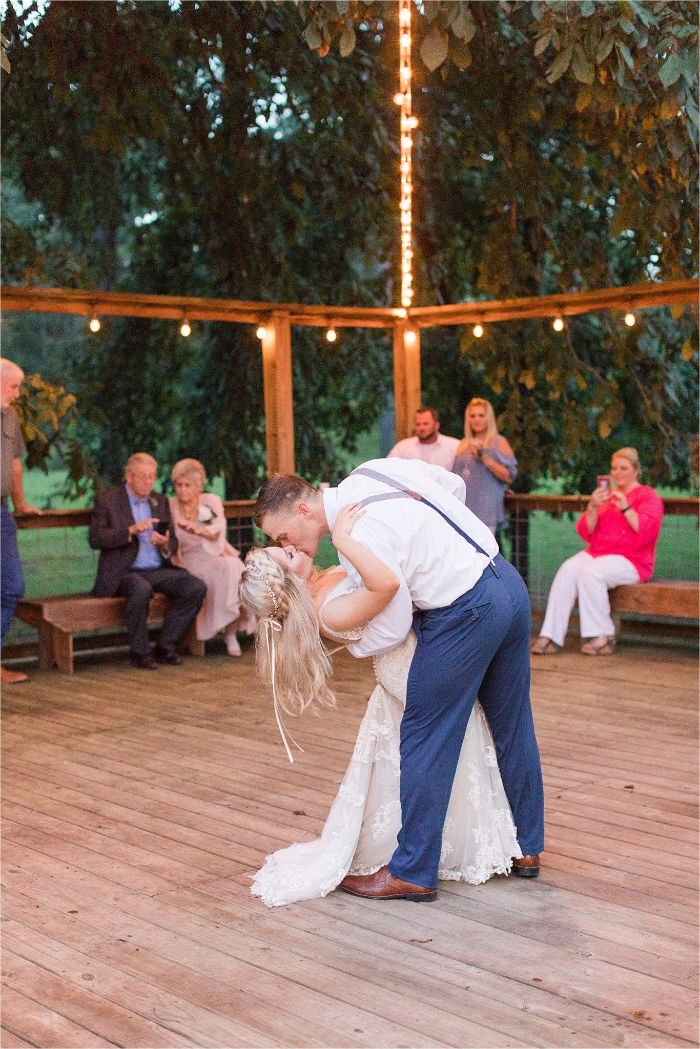 bride-groom-first-dance-dipping-kiss-wedding-reception-dance-floor