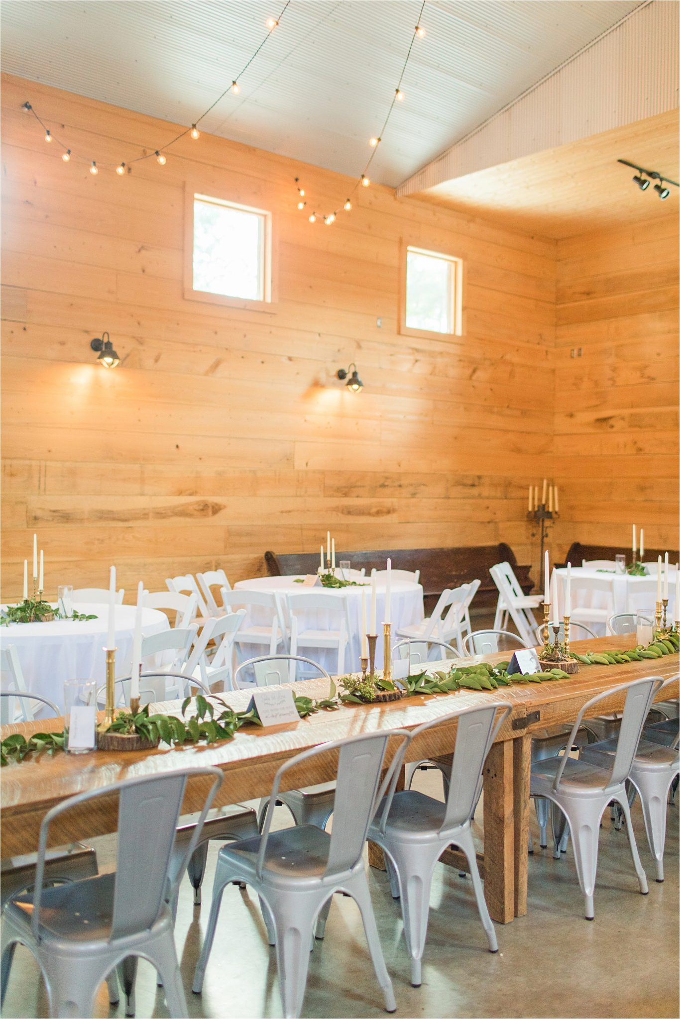 wedding-reception-alabama-venue-barn-farm-tables-metal-chairs-candle-centerpieces