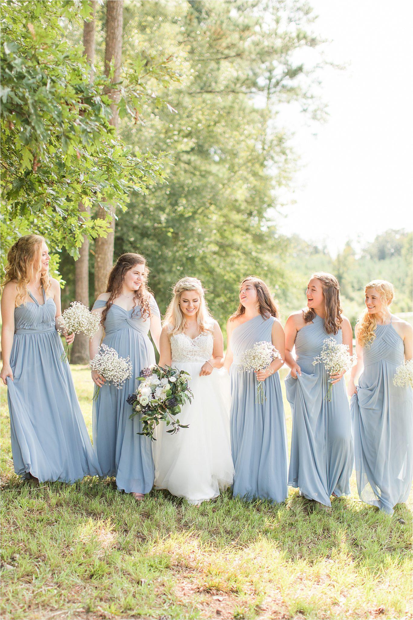 bride-bridesmaids-bouquets-periwinkle-long-dresses-different-cuts-styles