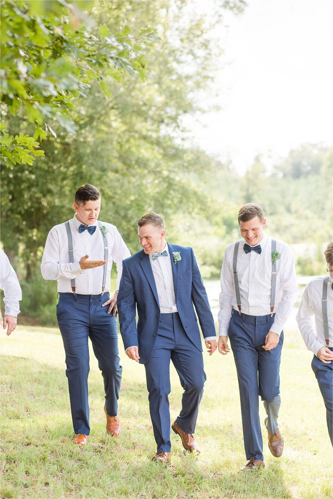 groom-groomsmen-blue-navy-bow-tie-suspenders-brown-shoes